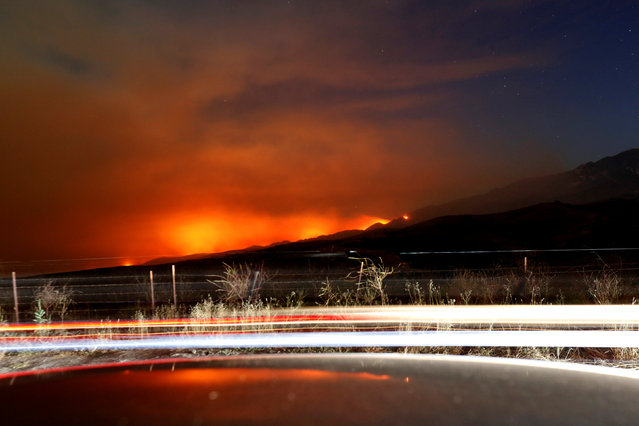 """The so-called """"Sherpa Fire"""" burns in the hills near Santa Barbara, California, U.S. June 16, 2016. Picture taken with a long exposure. (Photo by Mario Anzuoni/Reuters)"""