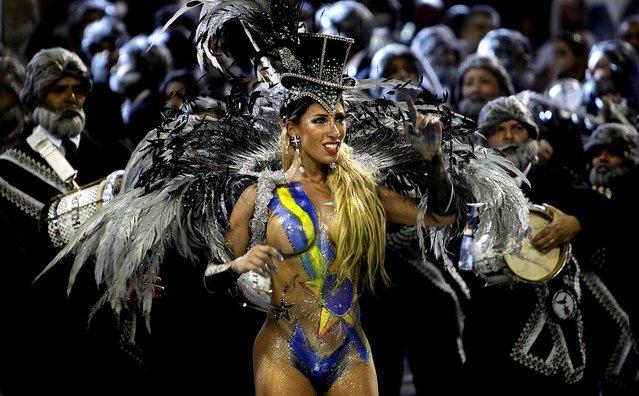 A dancer of the Gavioes da Fiel samba school performs in Sao Paulo