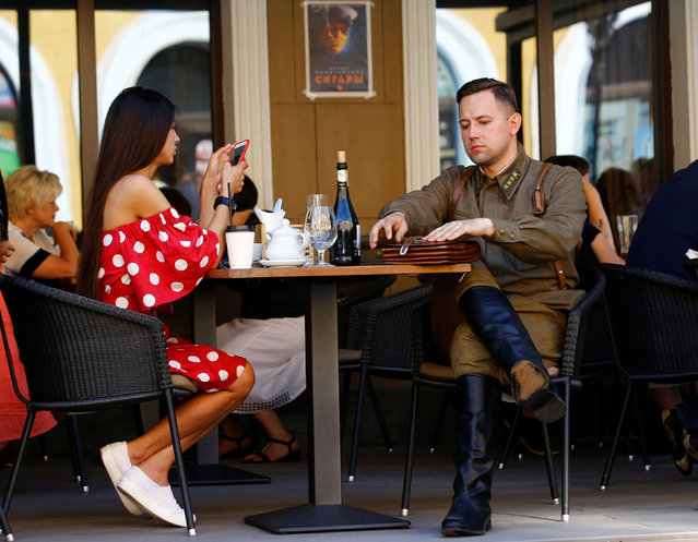 A military enthusiast dressed as World War Two Red Army officer sits in a cafe as he marks the 75th anniversary of the Nazi Germany invasion, in Brest, Belarus June 21, 2016. (Photo by Vasily Fedosenko/Reuters)