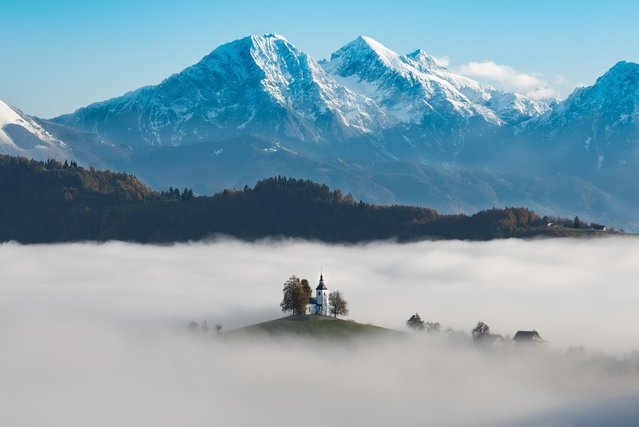 """After standing over an hour on a frosty mountainside in Skofja Loka, Slovenia, waiting for the sunrise over the mist filled valley, I was blessed with a ten minute appearance of St. Thomas Church"", wrote Joseph LaRose, 71, of Cherry Hill, N.J. (Photo by Joseph LaRose/2017 Washington Post Travel Photo Contest)"