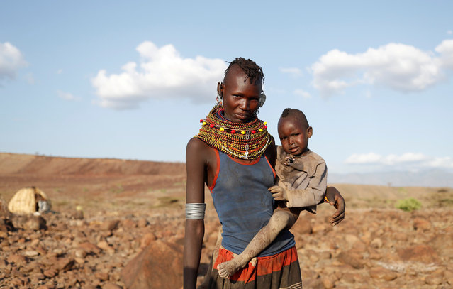 A Turkana tribeswoman holds her child in a village near Loiyangalani, Kenya August 4, 2017. (Photo by Goran Tomasevic/Reuters)