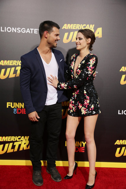 """Taylor Lautner and Kristen Stewart seen at The World Premiere of Lionsgate's """"American Ultra"""" at Ace Hotel on Tuesday, August 18, 2015, in Los Angeles, CA. (Photo by Eric Charbonneau/Invision for Lionsgate/AP Images)"""