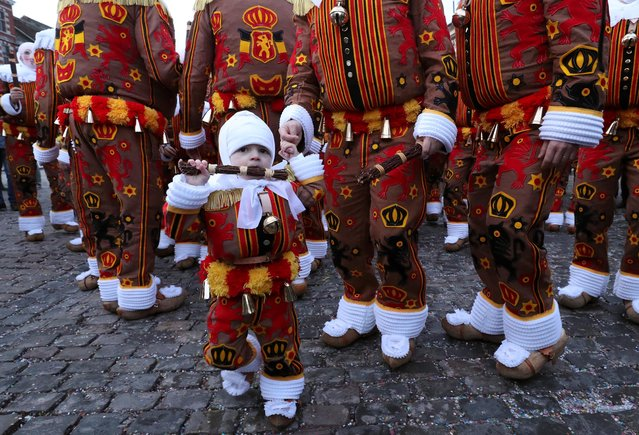 Chirico Largo, 2 years and 7 months old, one of the youngest Gilles of Binche, takes part in a parade during the Binche carnival, a UNESCO World Heritage event in Binche, Belgium February 25, 2020. (Photo by Yves Herman/Reuters)