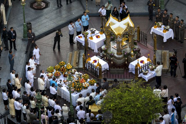 Thai government officials attend a religious ceremony at the Erawan shrine, the site of Monday's deadly blast, in central Bangkok, Thailand, August 21, 2015. (Photo by Athit Perawongmetha/Reuters)