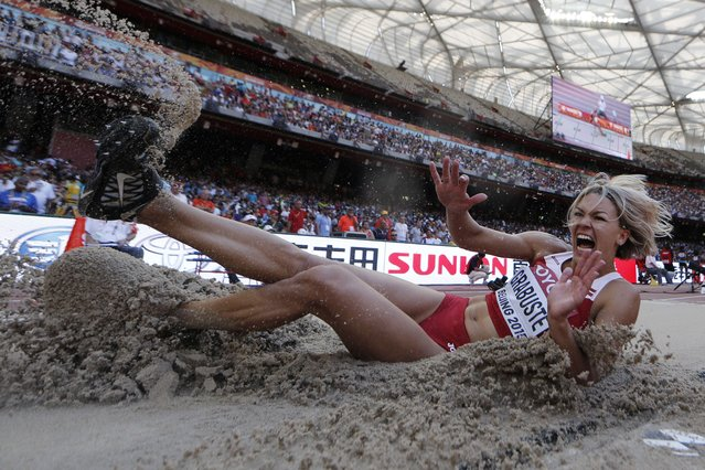 """Latvia's Aiga Grabuste competes in the qualifying round of the women's long jump athletics event at the 2015 IAAF World Championships at the """"Bird's Nest"""" National Stadium in Beijing on August 27, 2015. (Photo by Adrian Dennis/AFP Photo)"""