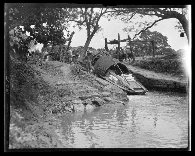 Boat on Mud Slide. China, Hangzhou, 1917-1919. (Photo by Sidney David Gamble)