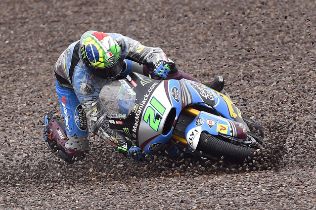 Moto2 driver Franco Morbidelli from Italy crashes during the Moto2 race on the Sachsenring in Hohenstein-Ernstthal, Germany, Sunday, July 17, 2016. (Photo by Jens Meyer/AP Photo)