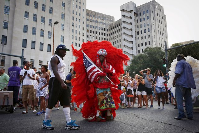 Horace Anderson, with the Creole Wild West Mardi Gras Indian Tribe, pauses in front of Charity Hospital, closed and vacant since Hurricane Katrina, in a second line parade to mark the tenth anniversary of the storm in New Orleans, Louisiana August 29, 2015. (Photo by Edmund D. Fountain/Reuters)