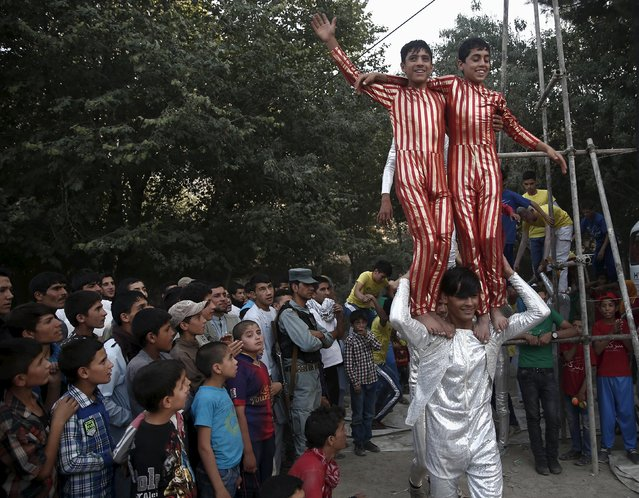 Boys, part of Afghan Mobile Mini Circus for Children (MMCC), arrive for a public performance during MMCC's festival in Kabul, Afghanistan August 14, 2015. (Photo by Ahmad Masood/Reuters)