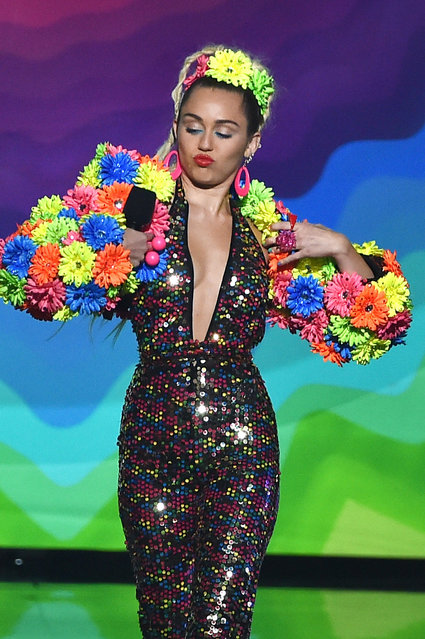 Host Miley Cyrus speaks onstage during the 2015 MTV Video Music Awards at Microsoft Theater on August 30, 2015 in Los Angeles, California. (Photo by Kevin Winter/MTV1415/Getty Images For MTV)
