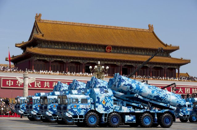 Military vehicles carry DF-10 ship-launched cruise missiles as they travel past Tiananmen Gate during a military parade to commemorate the 70th anniversary of the end of World War II in Beijing Thursday September 3, 2015. (Photo by Andy Wong/Reuters)