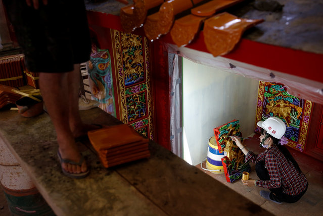An employee paints a ready-made Chinese traditional temple at the Chuanso factory that manufactures religious objects in Pingtung, Taiwan July 5, 2016. (Photo by Tyrone Siu/Reuters)