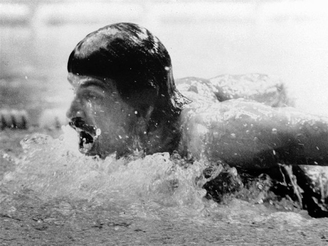 American swimmer, Mark Spitz, seen in the butterfly part on  September 4, 1972, in the 400-meter medley swimming event at the Summer Olympic swim hall in Munich, Germany. The American team placed first setting up a new world record in 3:48,16 min. (Photo by AP Photo)