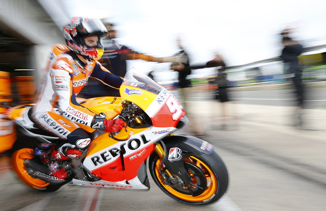 Honda MotoGP rider Marc Marquez of Spain exits his garage during the third practice session for the British Grand Prix at the Silverstone Race Circuit, central England, August 30, 2014. (Photo by Darren Staples/Reuters)