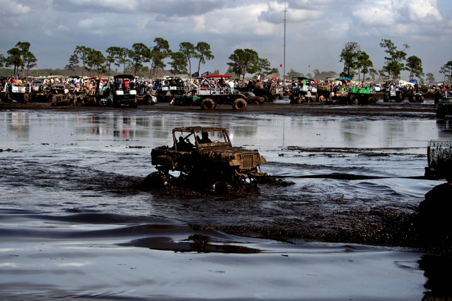 The 2012 Okeechobee Mudfest at 11705 Highway 70 East in Okeechobee. The three day festival has over 205 acres of mud pits for trucks, swamp buggies, all terrain vehicles and modified trucks. The cost is $40 for the weekend and includes overnight camping. (Photo by Gary Coronado/The Palm Beach Post)