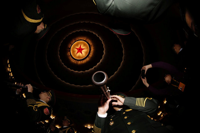 Military band members prepare inside the Great Hall of the People before the opening of the 19th National Congress of the Communist Party of China at the Great Hall of the People in Beijing, China on October 18, 2017. (Photo by Jason Lee/Reuters)