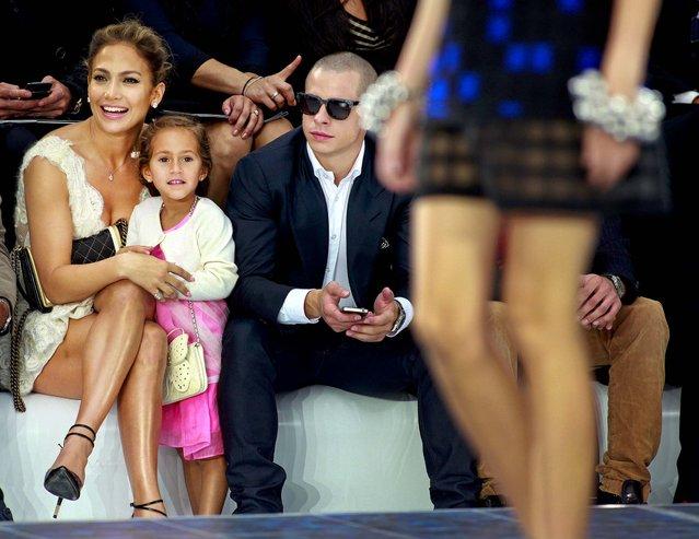 Jennifer Lopez, her boyfriend Casper Smart and her daughter Emme watch Chanel's ready to wear Spring-Summer 2013 collection, presented in Paris, Oktober 2, 2012. (Photo by Thibault Camus/Associated Press)