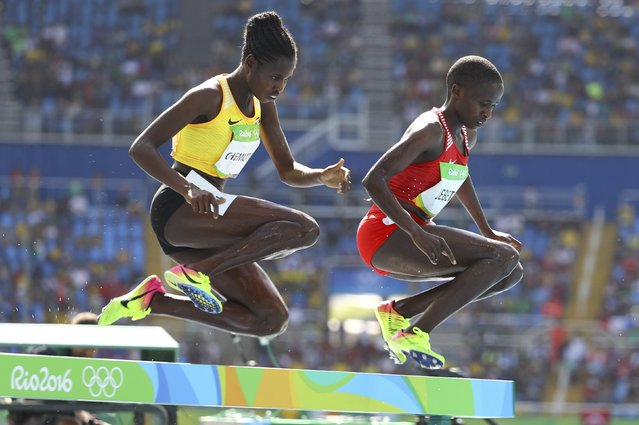 2016 Rio Olympics, Athletics, Preliminary, Women's 3000m Round 1, Olympic Stadium, Rio de Janeiro, Brazil on August 13, 2016. Peruth Chemutai (UGA) of Uganda and Ruth Jebet (BRN) of Bahrain compete. (Photo by Lucy Nicholson/Reuters)
