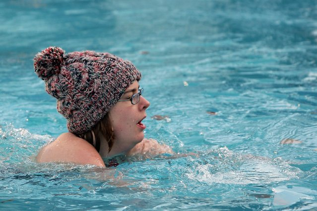 A swimmer wears a woollen hat during the Winter Swim at Brockwell Lido on December 19, 2009 in London, England. Ice had to be broken from the surface of the open air pool for the annual winter swim where swimmers of all ages brave the cold water for the honour of becoming a Brockwell Icicle and to raise money for charity. (Photo by Dan Kitwood)