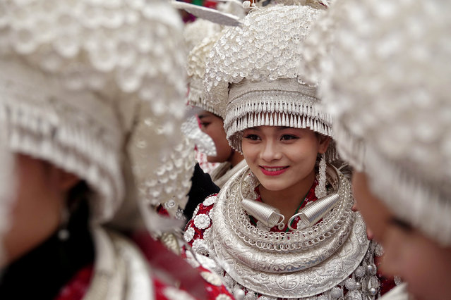 Ethnic Miao women wearing traditional costumes take part in a parade during the traditional Lusheng (reed-pipe wind instrument) festival in Gulong, Guizhou province, China November 15, 2017. (Photo by Reuters/China Stringer Network)