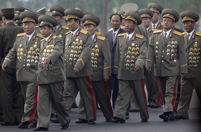 North Korean senior military officials arrive for the opening ceremony of the Cemetery of Fallen Fighters of the Korean People's Army in Pyongyang, July 25, 2013. (Photo by Jason Lee/Reuters)
