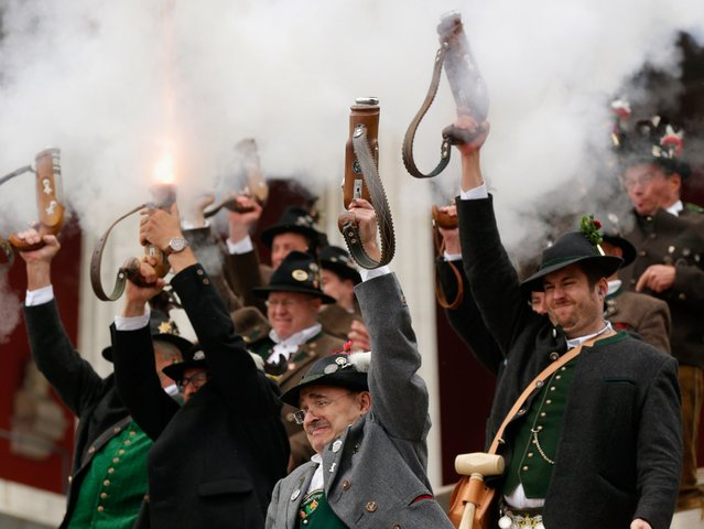 Bavarian riflemen of the Munich Salute Gun Regiment fire a traditional salute with one-shot guns on the last day of the 2014 Oktoberfest, October 5, 2014 in Munich. The 181st Oktoberfest drew millions of visitors from across the globe in the world's largest beer fest. (Photo by Johannes Simon/Getty Images)