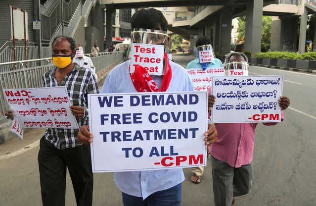 Activists of Communist Party of India Marxist wearing face shields and hold placards during a protest asking the state government to increase testing and free treatment for all COVID-19 patients in Hyderabad, India, Monday, June 29, 2020. Governments are stepping up testing and warily considering their next moves as the number of newly confirmed coronavirus cases surges in many countries. India reported more than 20,000 new infections on Monday. (Photo by Mahesh Kumar A./AP Photo)