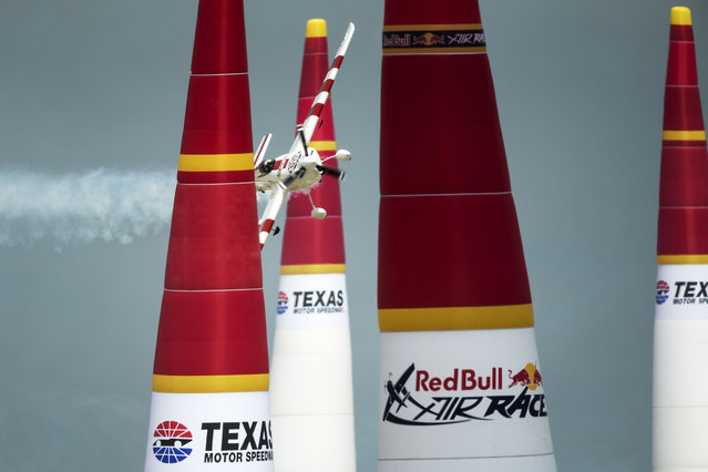 Paul Bonhomme of Great Britain performs during the finals for the sixth stage of the Red Bull Air Race World Championship at the Texas Motor Speedway in Fort Worth, Texas, United States on September 7, 2014. (Photo by Joerg Mitter/Red Bull)