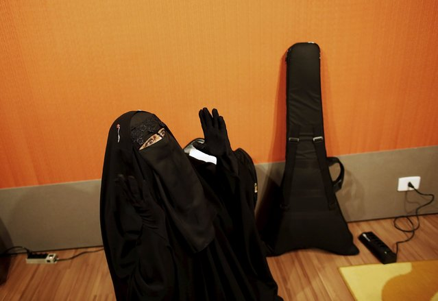Gisele Marie, a Muslim woman and professional heavy metal musician, gestures before a rehearsal at a studio in Sao Paulo January 21, 2015. (Photo by Nacho Doce/Reuters)