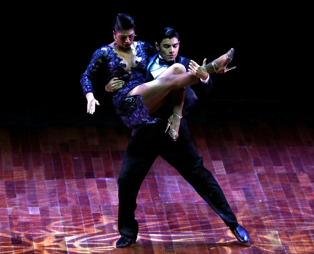 Valentin Arias Delgado and Diana Franco Durango, from Colombia, perform their routine on their way to win the third place at the Stage style Tango World Championship, in Buenos Aires, Argentina, August 31, 2016. (Photo by Enrique Marcarian/Reuters)