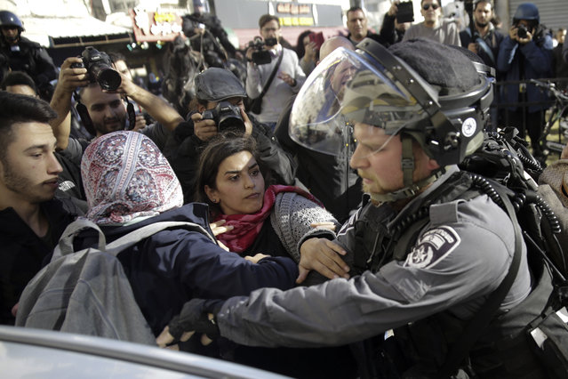 Israeli policeman scuffles with Palestinian women during a protest against U.S. President Donald Trump's decision to recognize Jerusalem as the capital of Israel in Jerusalem, Saturday, December 9, 2017. (Photo by Mahmoud Illean/AP Photo)