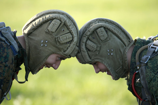 Students from the Yermolov Cadet School test their helmets before a parachute jump outside the southern Russian city of Stavropol, May 17, 2012. (Photo by Eduard Korniyenko/Reuters)