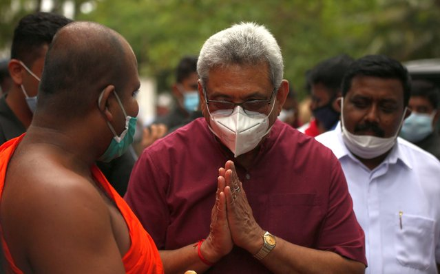 Sri Lankan President Gotabaya Rajapaksa wearing a face mask greets a Buddhist monk at the inauguration of Sri Lanka Podujana Peramuna (SLPP)'s election campaign leading up to the parliamentary elections at Anuradhapura (200km from capital Colombo), Sri Lanka on July 3, 2020. Accordingly, President Rajapaksa attended several public gatherings held in the Anuradhapura district to ensure the victory of the SLPP candidates contesting the upcoming general election. SLPP, Sri Lanka Podujana Peramuna is headed by President Gotabaya Rajapaksa's brother, prime minister Mahinda Rajapaksa. Sri Lanka will hold the Parliamentary Election on August 05 2020. (Photo by Tharaka Basnayaka/NurPhoto via Getty Images)
