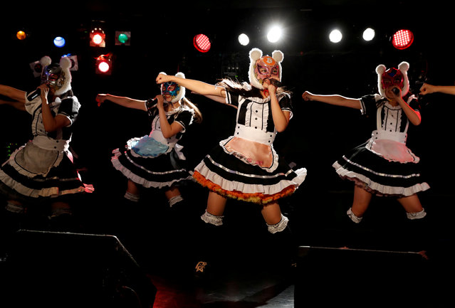 "Members of Japan's idol group ""Virtual Currency Girls"" wearing cryptocurrency-themed masks perform in their debut stage event in Tokyo, Japan, January 12, 2018. (Photo by Kim Kyung-Hoon/Reuters)"