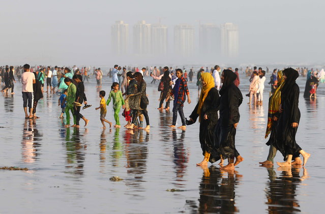 People visit the beach after the government lifted most of the country's remaining coronavirus restrictions, in Karachi, Pakistan, 18 August 2020. (Photo by Shahzaib Akber/EPA/EFE)