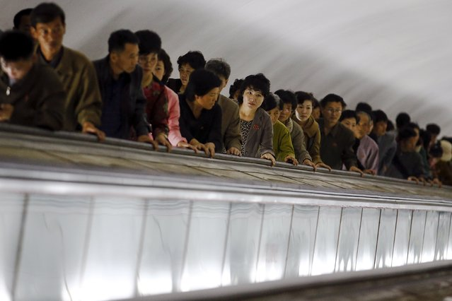 People use escalators to leave a subway station visited by foreign reporters during a government organised tour in Pyongyang, North Korea October 9, 2015. (Photo by Damir Sagolj/Reuters)
