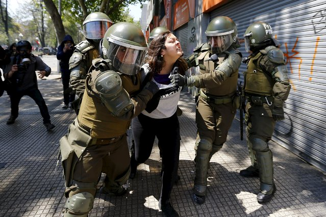 A student protester is detained during a demonstration to demand changes in the education system in Santiago, Chile, October 15, 2015. (Photo by Ivan Alvarado/Reuters)