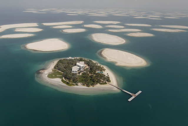 A development is seen on one of the islands of The World Islands project in Dubai, January 7, 2012. (Photo by Jumana El Heloueh/Reuters)