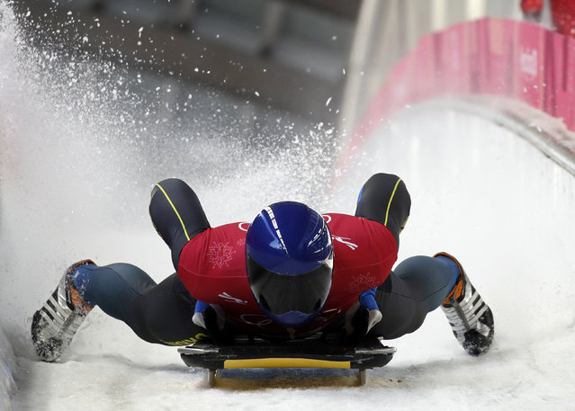 Vladyslav Heraskevych of Ukraine brakes in the finish area during a training run for the men's skeleton at the 2018 Winter Olympics in Pyeongchang, South Korea, Tuesday, February 13, 2018. (Photo by Jae C. Hong/AP Photo)