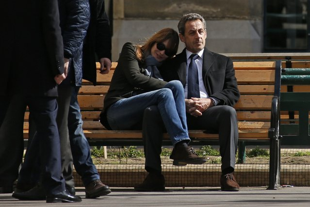Former French President Nicolas Sarkozy sits on a bench with his wife Carla Bruni-Sarkozy in Paris, in this March 23, 2014 file photo. I was covering the first round of the French municipal elections in Paris and went to a local poll station in a school where Nicolas Sarkozy and Carla Bruni-Sarkozy were due to cast their votes. (Photo and caption by Benoit Tessier/Reuters)