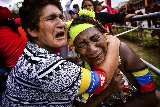 Supporters of the late President Hugo Chavez react after watching the funeral procession in Caracas, on March 15, 2013. (Photo by Meridith Kohut/The New York Times)