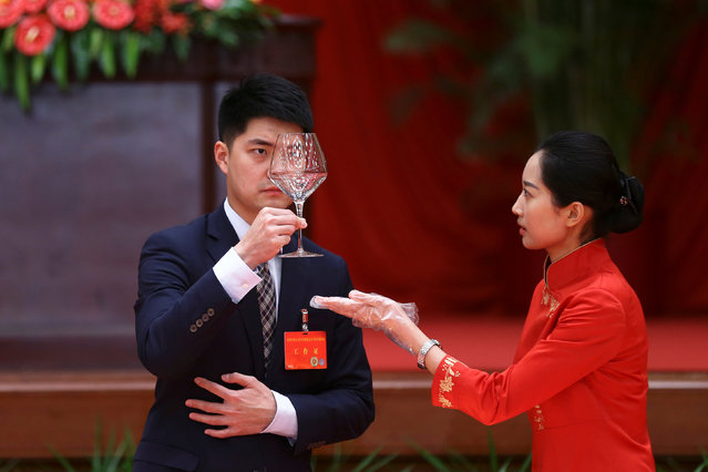 A glass is checked at the table for China's top leaders before the start of a reception to celebrate National Day at the Great Hall of the People in Beijing, China September 30, 2016. (Photo by Damir Sagolj/Reuters)