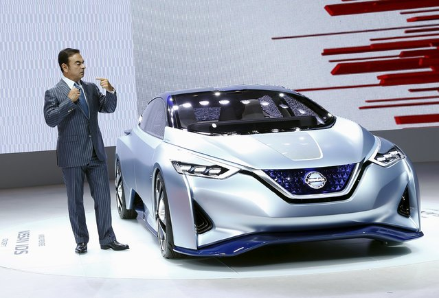 Carlos Ghosn, CEO of the Renault-Nissan Alliance, presents the Nissan IDS concept car at the 44th Tokyo Motor Show in Tokyo October 28, 2015. (Photo by Thomas Peter/Reuters)