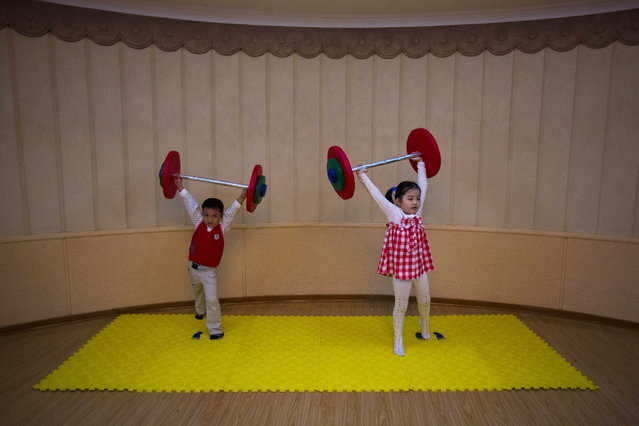 North Korean children lift toy barbells during play time at a school for the performing arts in Pyongyang, North Korea Thursday, September 13, 2012. (Photo by David Guttenfelder/AP Photo)