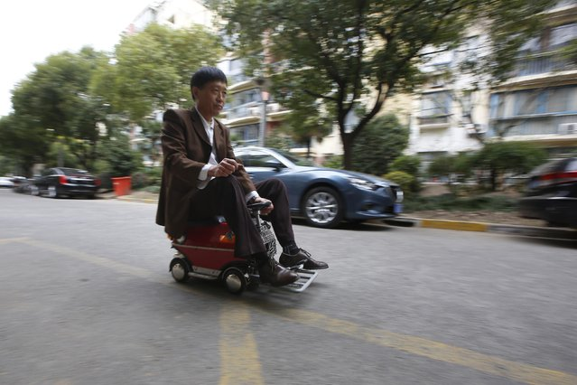 Xu Zhiyun, 60, drives his home-made motorised mini-vehicle along a street in Shanghai December 9, 2014. (Photo by Aly Song/Reuters)