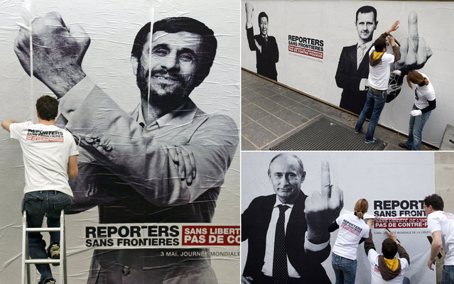 Reporters Without Borders exposes montages of world leaders, including Mahmoud Ahmadinejad (Iran), Xi Jinping (China) and Bashar al-Assad (Syria) and Vladimir Putin (Russia) in Paris, marking the 20th World Day of Freedom Media. (Photo by Benoit Tessier/Reuters)