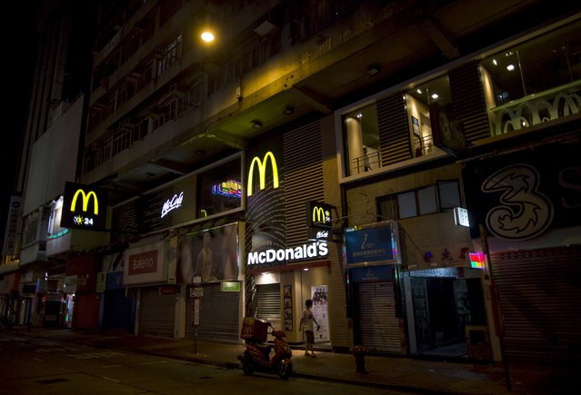A man walks past at a 24-hour McDonald's restaurant in Hong Kong, China November 10, 2015. (Photo by Tyrone Siu/Reuters)