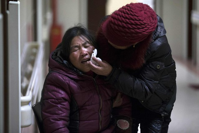 A woman cries at a hospital after a stampede occurred during a New Year's celebration on the Bund, central Shanghai January 1, 2015. (Photo by Aly Song/Reuters)