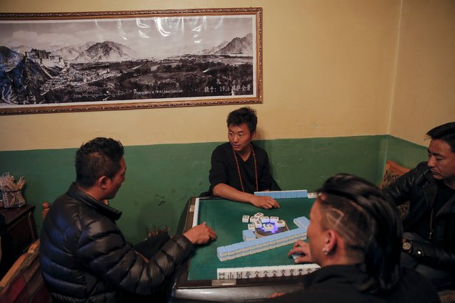 People play mahjong inside a shop in the old part of Lhasa, Tibet Autonomous Region, China November 16, 2015. (Photo by Damir Sagolj/Reuters)