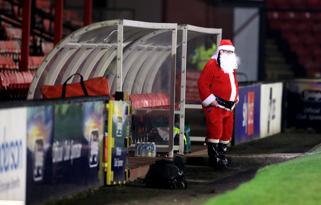 A man wearing a Santa Claus costume in the dug out ahead of the Sky Bet League Two match at Blundell Park, Grimsby on December 22, 2020. (Photo by Mike Egerton/PA Images via Getty Images)